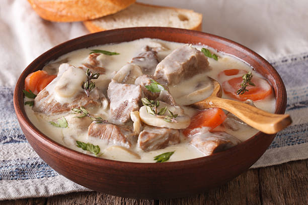 Veal with mushrooms in cream sauce in a bowl. horizontal Veal with mushrooms in cream sauce in a bowl on the table. horizontal ragout stock pictures, royalty-free photos & images