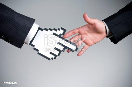 istock Vector cursor handshake on a real hand 157590945