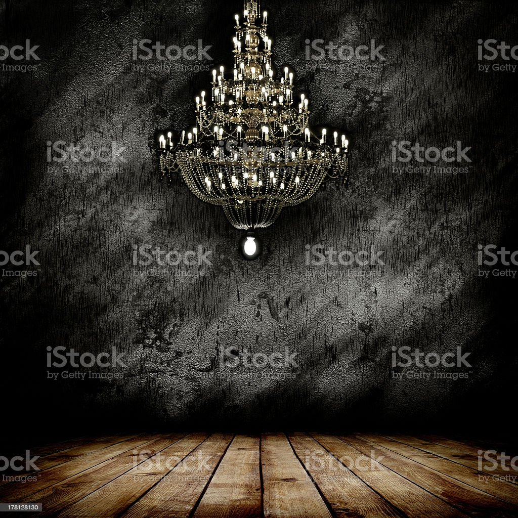 Vector illustration of a chandelier on a dark empty room stock photo