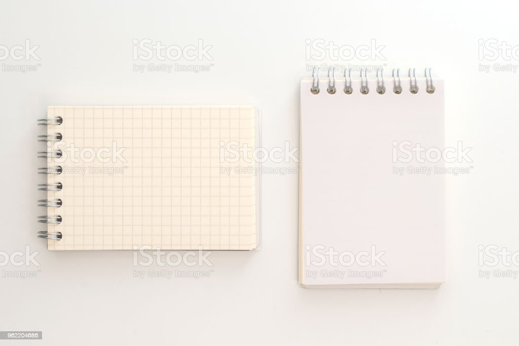 Vector realistic opened notebook. Vertical blank copybook with metallic stock photo