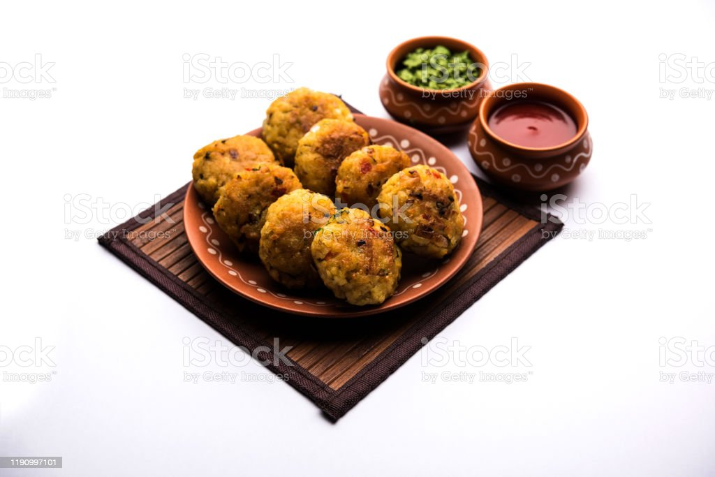 Veg Poha Roll, patties or Tikki Veg Poha Roll, patties or Tikki made using flattened Rice, served with tomato ketchup and green chutney Aloo Tikki Stock Photo