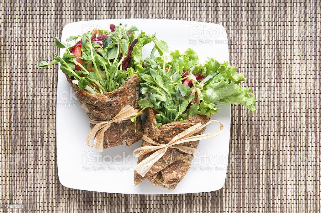 Vegan and Raw Food Wrap on Natural Fibre Placemat stock photo
