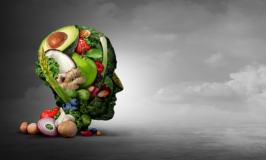 Vegan and vegetarian psychology concept with a group of fruit nuts beans and vegetable as an eating lifestyle and  thinking healthy diet as farm fresh produce shaped as a head in a 3D illustration style.