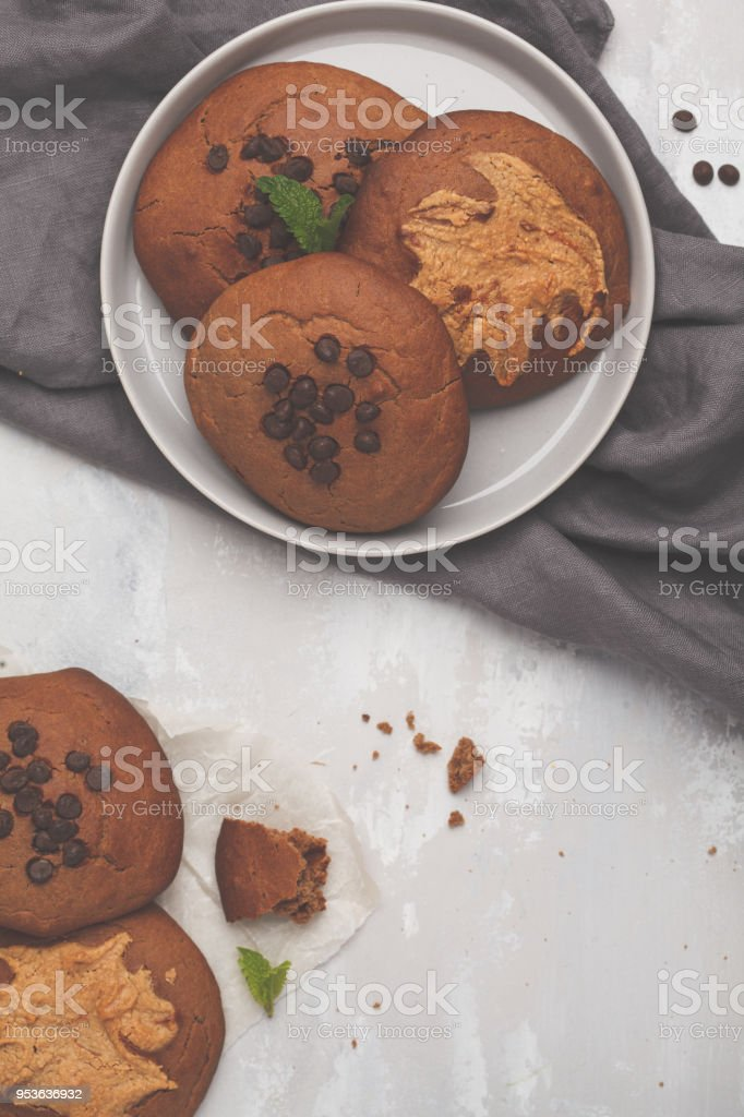 Vegan aquafaba peanut butter cookies with carob and chocolate drops, top view. Healthy vegan food concept. stock photo