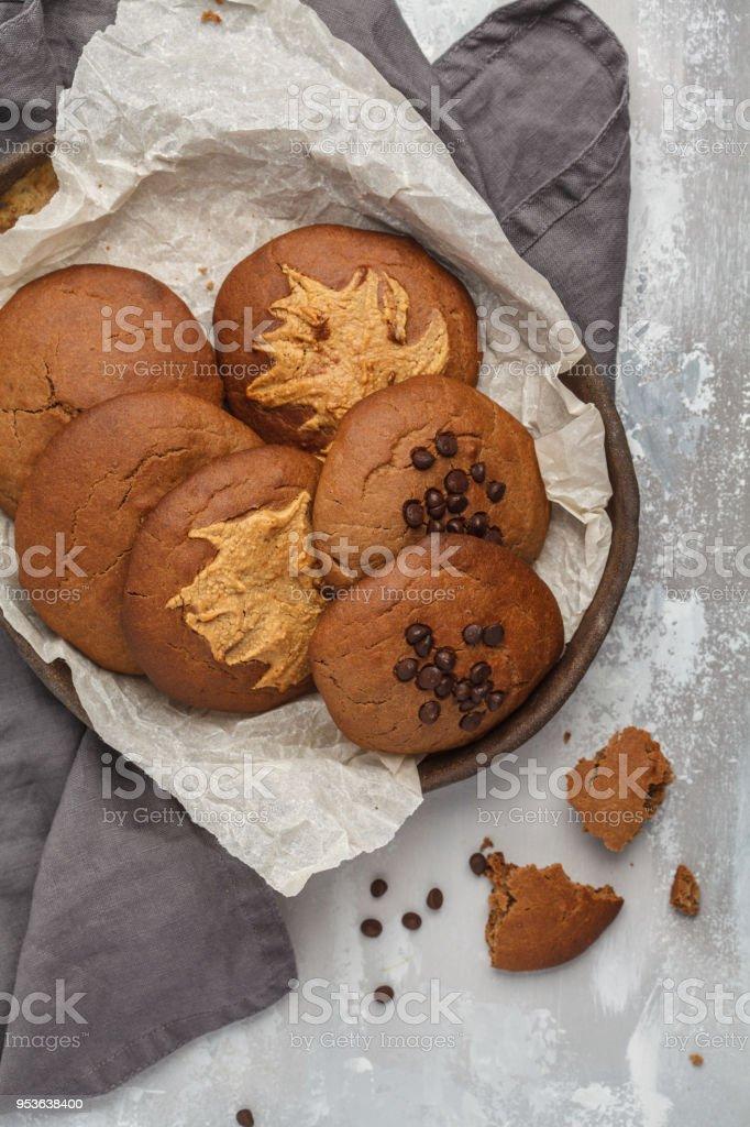 Vegan aquafaba peanut butter cookies with carob and chocolate drops. Healthy vegan food concept. stock photo