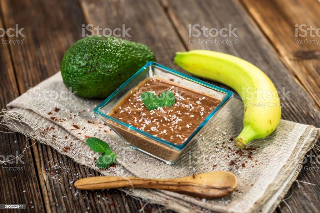 Vegan avocado banana chocolate pudding stock photo