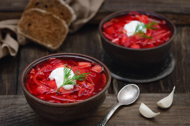 Vegan borscht in bowls on an old wooden background stock photo