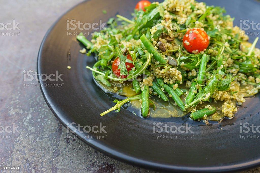 Vegan carpaccio with quinoa rucola salad stock photo