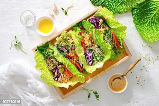 Vegan detox spring rolls with quinoa, sprouts and Thai peanut sauce, view from above, flat lay