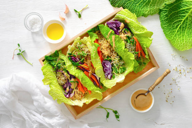 vegan detox spring rolls with quinoa, sprouts and thai peanut sauce - lettuce stock pictures, royalty-free photos & images