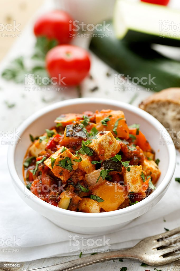 Vegan dish with tofu and vegetables stock photo