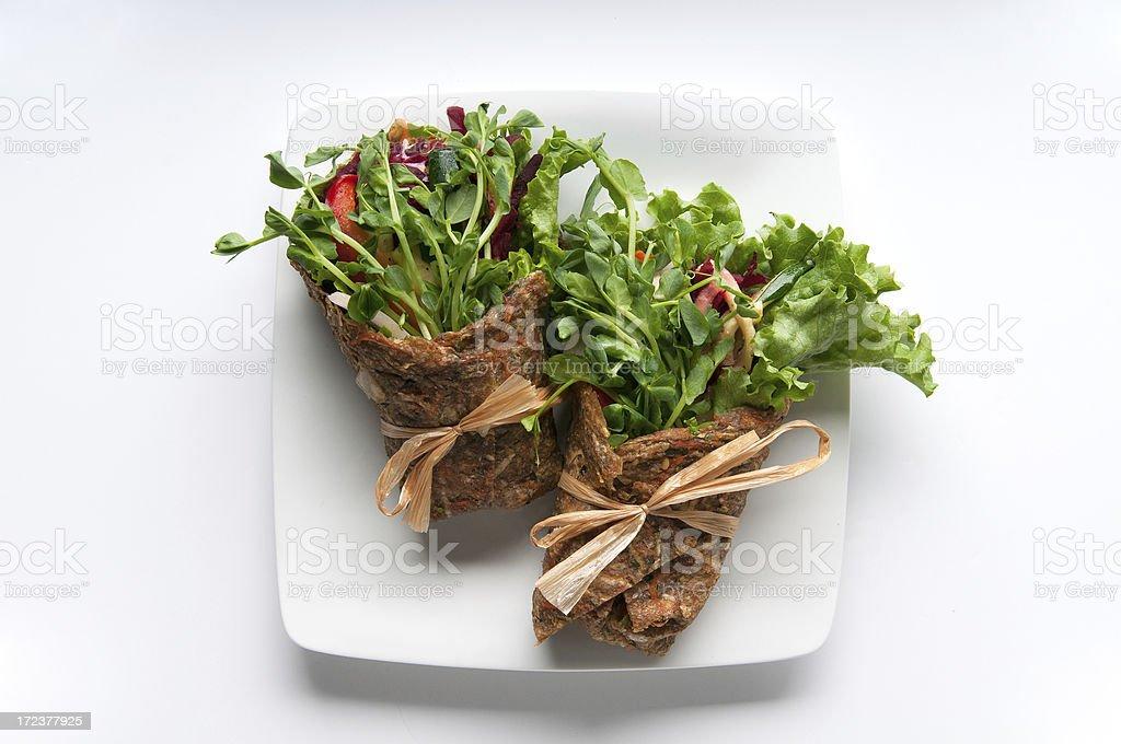 Vegan Falafel Wraps on a White Plate stock photo
