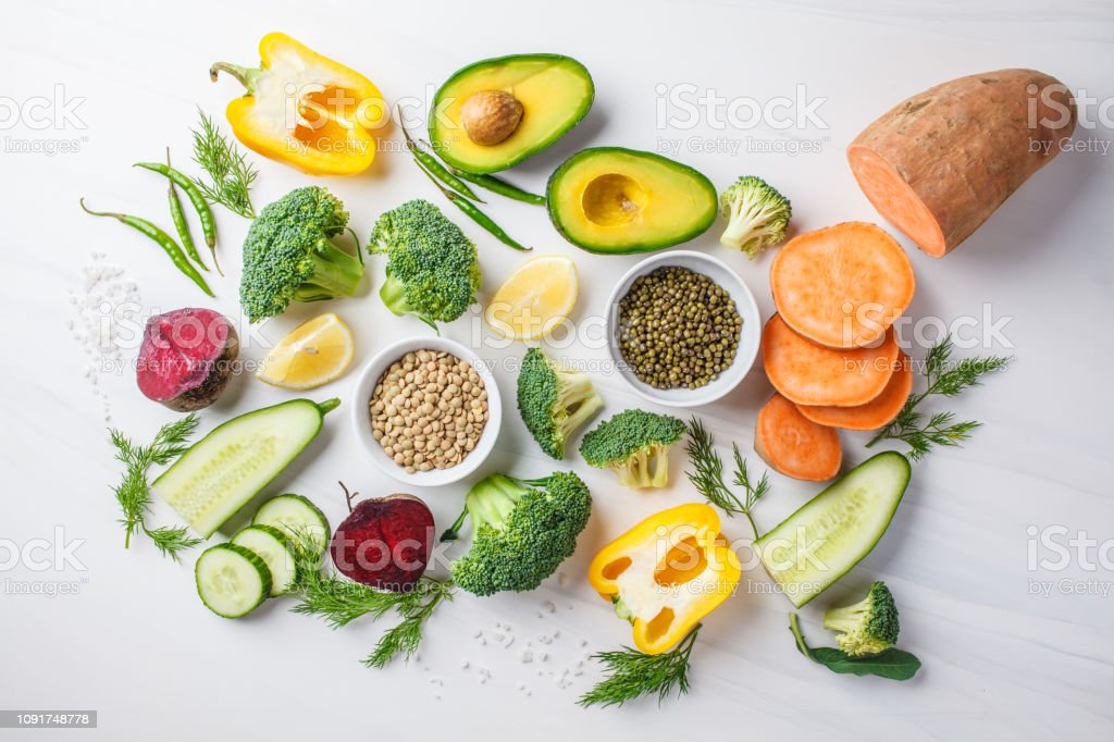 Vegan food background. Balanced food ingredients on a white...