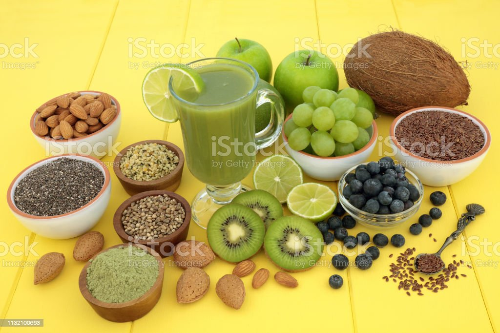 Vegan health food smoothie juice drink with fresh fruit, matcha...