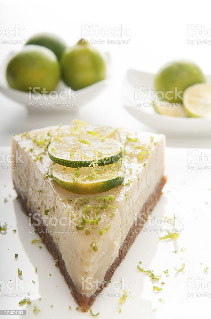 Vegan Key Lime Pie Slice and Key Limes stock photo