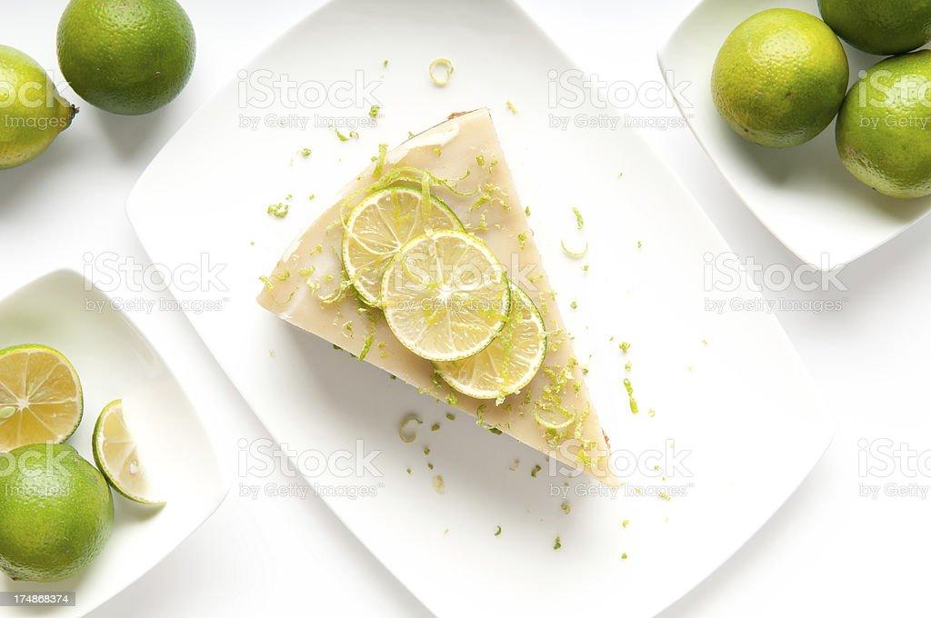 Vegan Key Lime Pie Slice and KeyLimes royalty-free stock photo