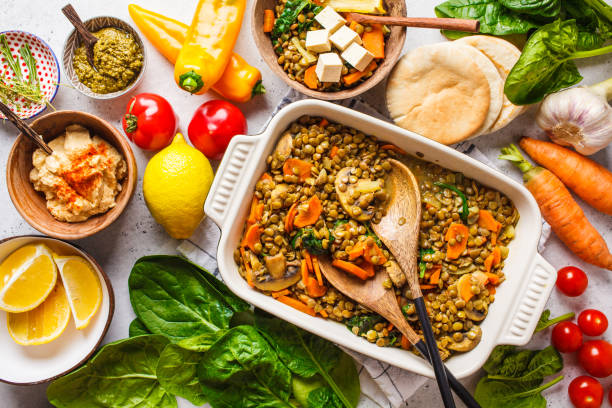 vegan lentil curry with vegetables, top view. healthy plant based food background. - vegetariano foto e immagini stock