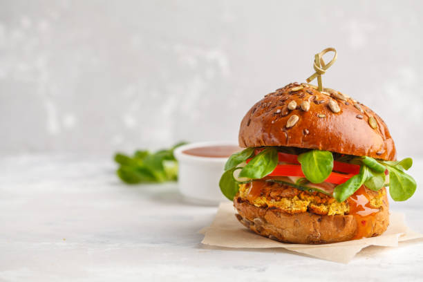 Vegan lentils burger with vegetables and curry sauce light background picture id921991094?b=1&k=6&m=921991094&s=612x612&w=0&h=8v3tom5izwif uln6mrrgq4s 8nyes4ad0umja e3iy=