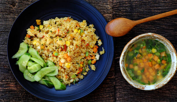Vegan meal for dinner, pilaw fried rice with soup from vegetables stock photo
