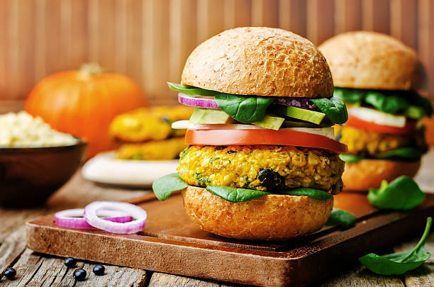 vegan millet black bean pumpkin burgers stock photo
