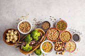 Vegan protein source. Tofu, beans, chickpeas, nuts and seeds on a white background, top view, copy space. Healthy vegetarian food concept.
