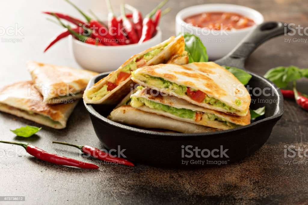 Vegan quesadillas with avocado and red pepper royalty-free stock photo