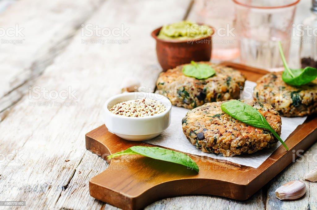 vegan quinoa eggplant spinach chickpeas Burger stock photo