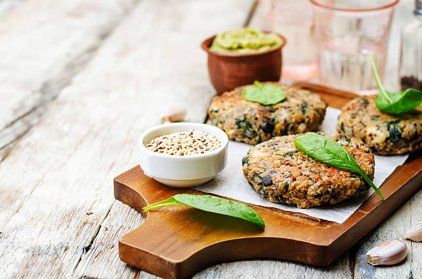 vegan quinoa eggplant spinach chickpeas Burger stock photo
