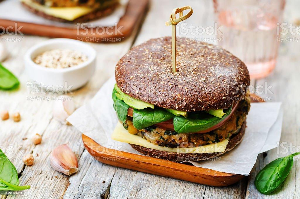 vegan quinoa eggplant spinach chickpeas rye Burger stock photo