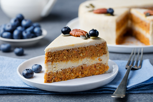 Vegan, raw carrot cake. Healthy food. Grey background