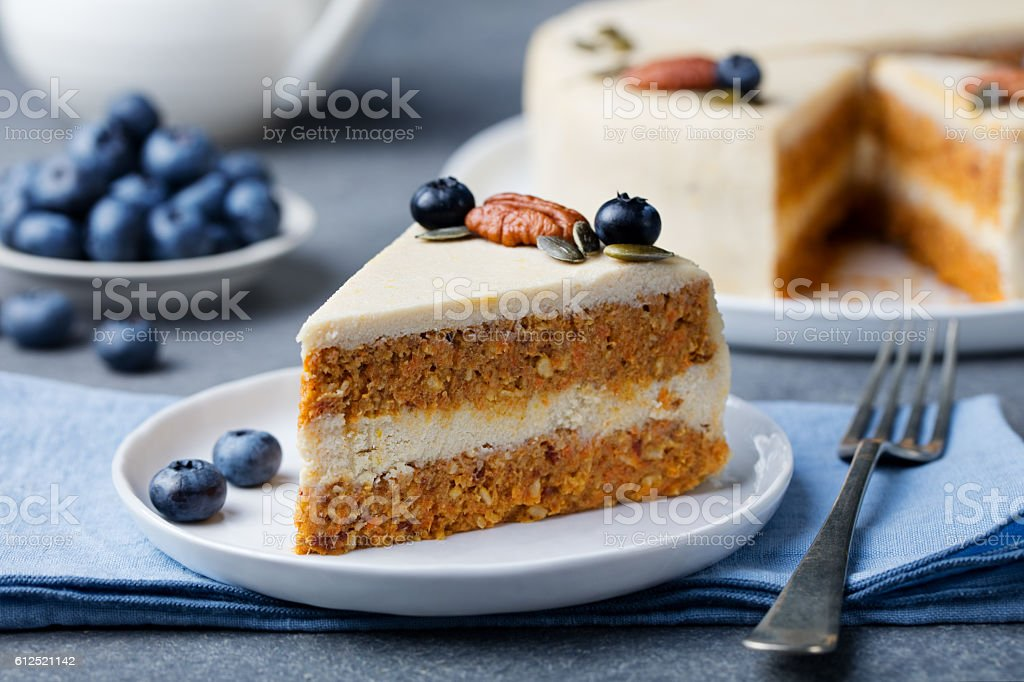 Vegan, raw carrot cake. Healthy food. Grey background stock photo