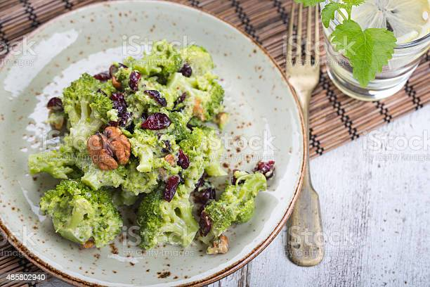 Vegan Salad With Broccoli Walnut And Dried Cherry Stock Photo - Download Image Now