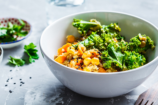 istock Vegan stew with chickpeas, sweet potato and kale in white bowl. 1176497586