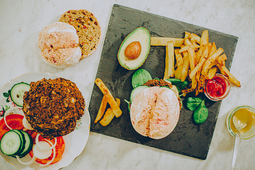 Vegan vegetable burger with avocado and chips