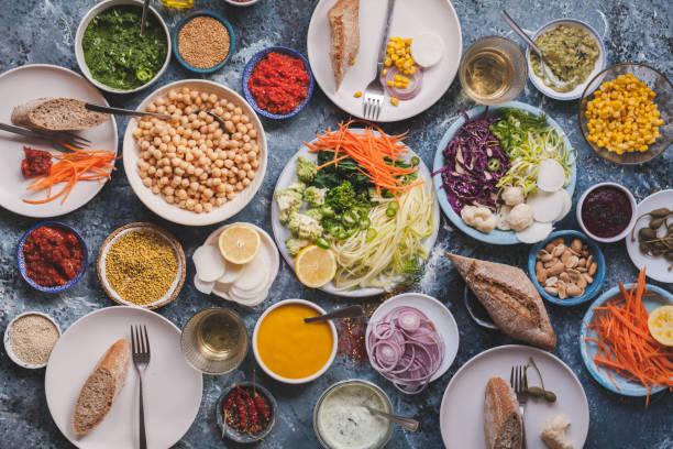 Vegan veggies meals on dinning table flat lay detox dieting food concept stock photo
