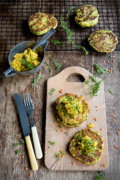 Vegan zucchini burgers with red lentil paste stock photo