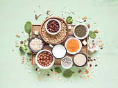 istock Vegetable albumen sources. Plant protein (beans, nuts, vegetables, mushrooms, seeds) on green background. 958372074