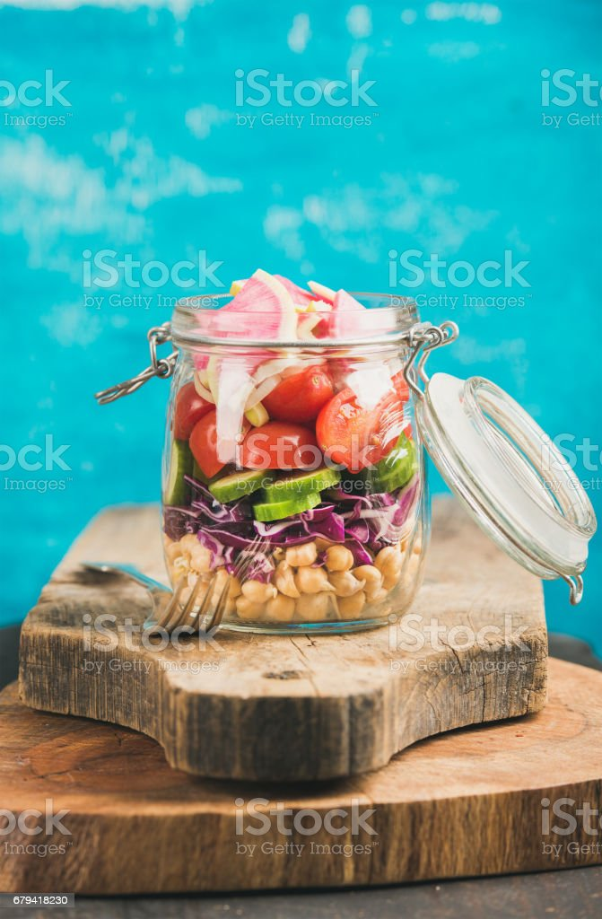 Vegetable and chickpea sprout vegan salad in jar, copy cpace royalty-free stock photo