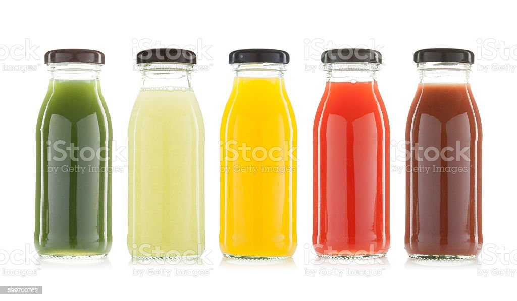 vegetable and fruit juice bottles isolated - foto stock