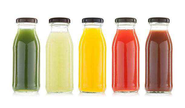 vegetable and fruit juice bottles isolated - foto de stock