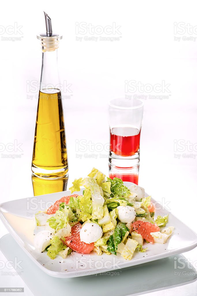 Vegetable and grape fruit salad with bocconcini cheese. stock photo