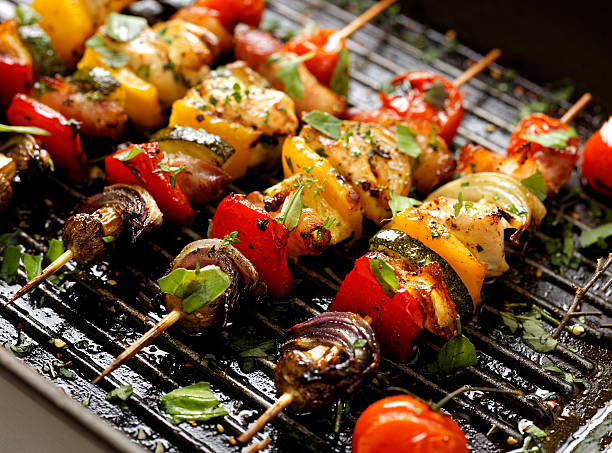 vegetable and meat skewers in a herb marinade - grilled stock photos and pictures