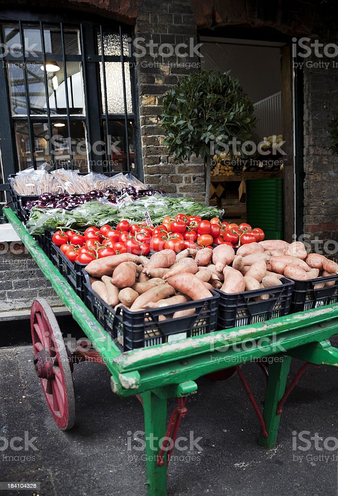 Vegetable barrow outside a greengrocery shop royalty-free stock photo