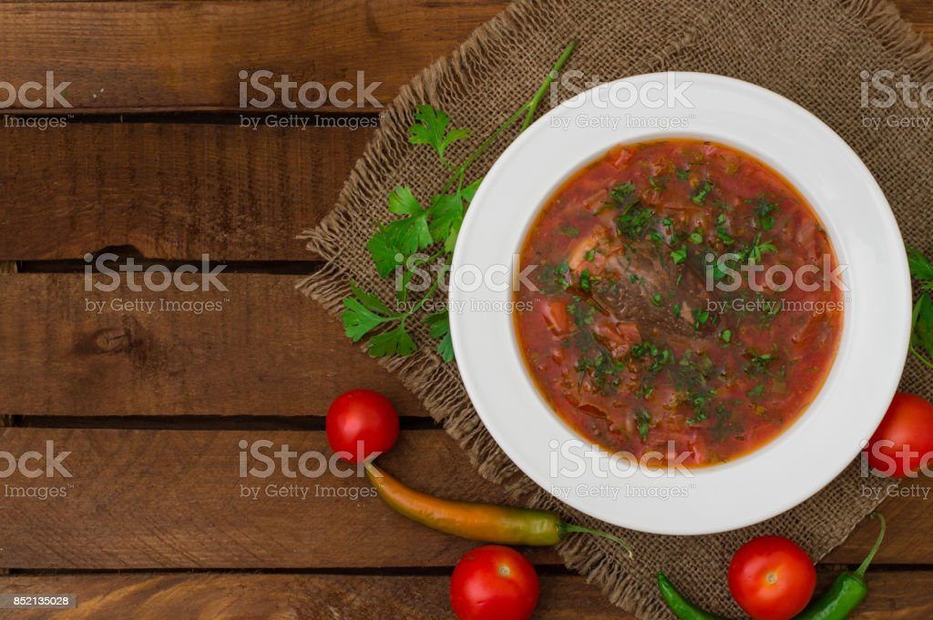 Vegetable borscht. Traditional Ukrainian and Russian soup. Wooden background. Close-up. Top view stock photo