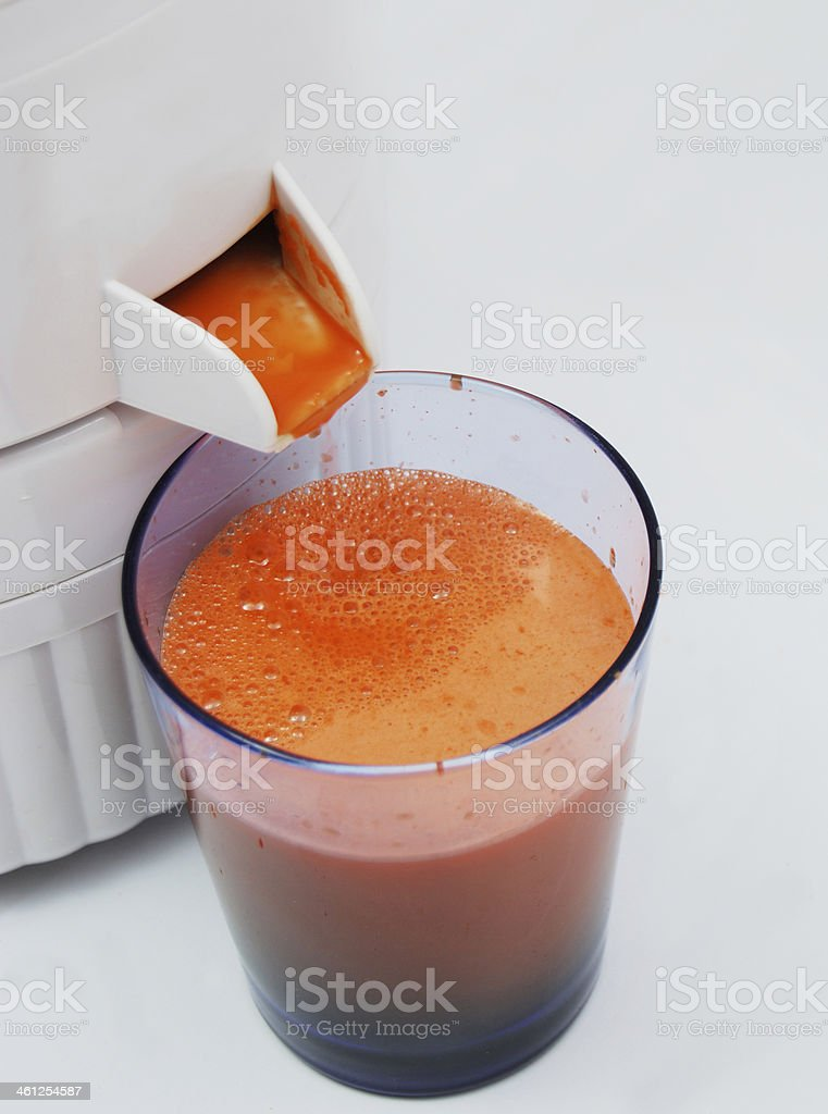 Vegetable Carrot Juice with Juicing Machine royalty-free stock photo