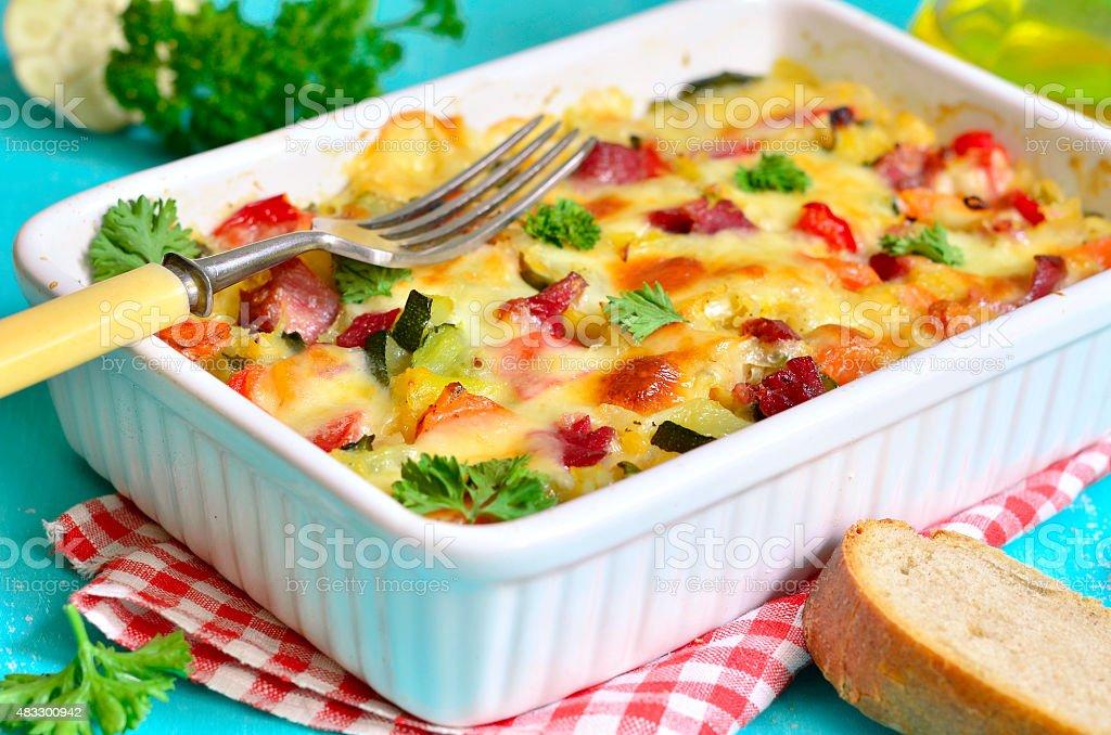 Vegetable casserole with pork shank. stock photo
