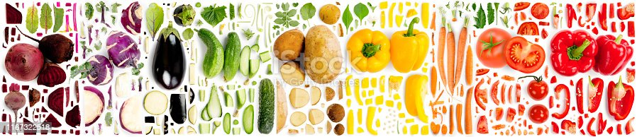 Large collection of colorful vegetable pieces, slices and leaves isolated on white background. Top view. Seamless abstract pattern.