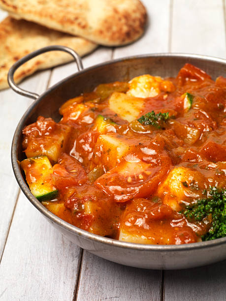 Vegetable curry Balti curry dish with nan bread balti dish stock pictures, royalty-free photos & images