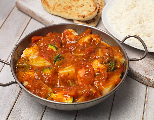 Vegetable Curry Balti dish with rice and nan bread balti dish stock pictures, royalty-free photos & images
