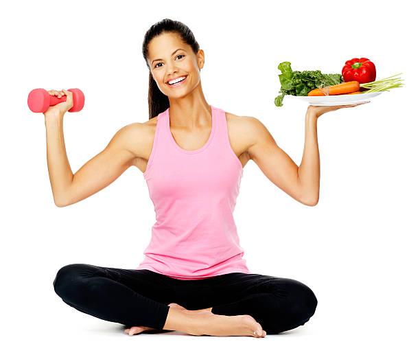 mujer de ejercicios de vegetales - comida india fotografías e imágenes de stock